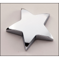 New   Chrome finished metal star paperweight.